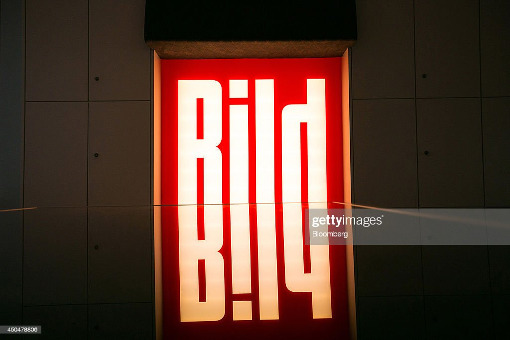 The logo of tabloid newspaper Bild, published by Axel Springer SE, sits illuminated in the company's offices in Berlin, Germany, on Wednesday, June 11, 2014. Axel Springer, Europe's biggest newspaper publisher, is working with JPMorgan Chase & Co. and Citigroup Inc. on an initial public offering of its digital-classifieds business, people familiar with the matter said. Photographer: Krisztian Bocsi/Bloomberg via Getty Images