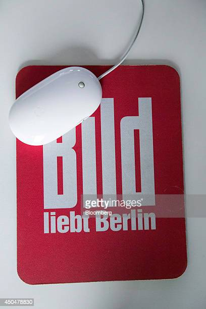 The logo of tabloid newspaper Bild published by Axel Springer SE sits on a computer mouse mat inside the company's offices in Berlin Germany on...