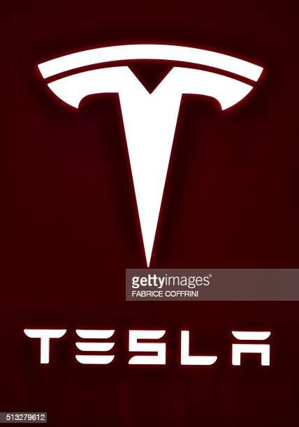 The logo of Tesla Motors is seen at the stand of US electric carmaker during the press day of the Geneva Motor Show on March 2 2016 in Geneva / AFP /...