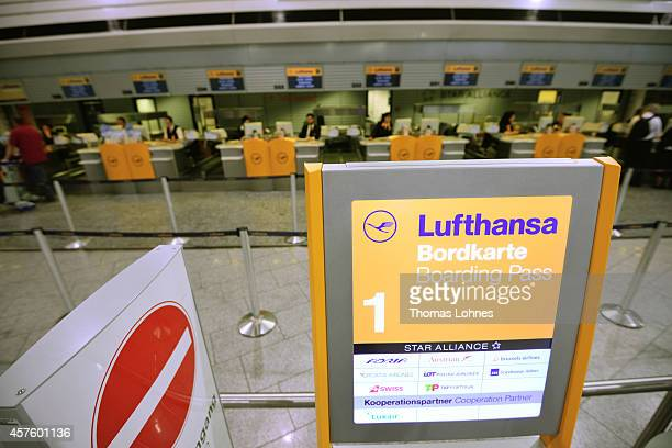 The logo of the airline Lufthansa pictured in front of the empty counter at the Frankfurt Airport on October 21 2014 in Frankfurt am Main Germany...