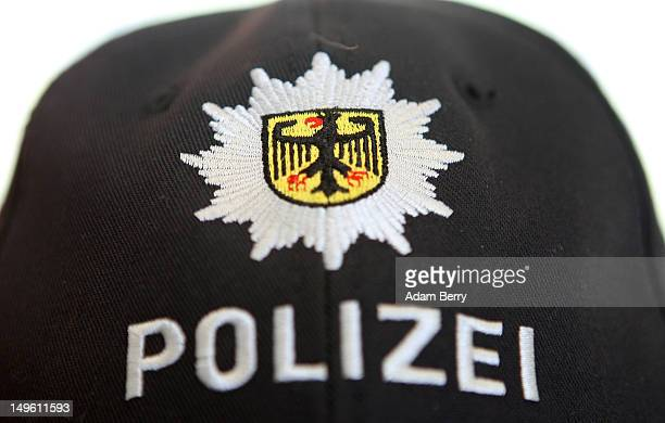 The logo of the Bunespolizei is seen on a police officer's cap at Tegel airport on August 1 2012 in Berlin Germany The topic of today's German...