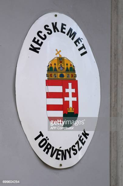 The logo of the courthouse in Kecskemet is pictured on June 21 on the first day of a trial of an international smuggler group in connection with...
