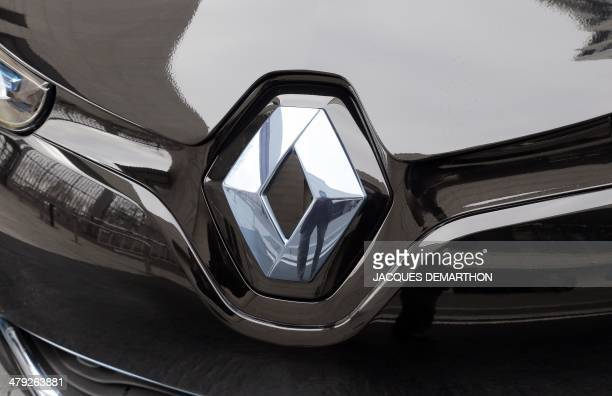 The logo of the French carmaker Renault's electric car Zoe is seen on March 17 2014 in Paris at the charging station for electric vehicles dedicated...