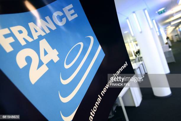 The logo of the French new international news TV channel is seen 13 September 2006 in the editing room at the headquarters in IssylesMoulineaux Paris...