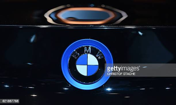 The logo of the German car maker BMW is pictured during the socalled AutoGipfel automotive meeting in Munich southern Germany on November 9 2016 /...