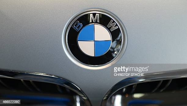 The logo of the German car maker BMW is seen at the front of a new car of German car maker BMW at the 'BMW World' delivery center near the company's...