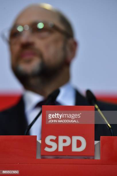 The logo of the Germany's social democrat party is pictured as Martin Schulz leader of Germany's social democrat SPD party addresses journalists...
