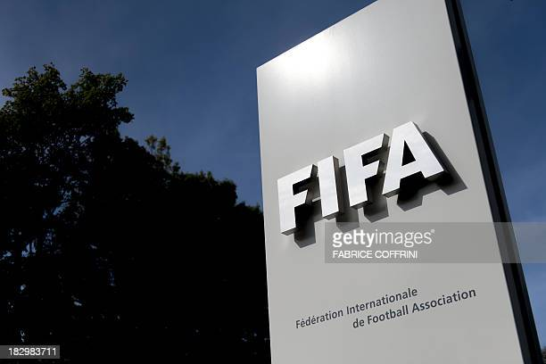The logo of the global football's governing body FIFA is seen on October 3 2013 at its headquarters in Zurich FIFA kicked off a crunch meeting behind...