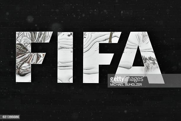 The logo of the International Federation of Association Football is pictured during snowfall at the FIFA headquarters in Zurich during meeting of the...
