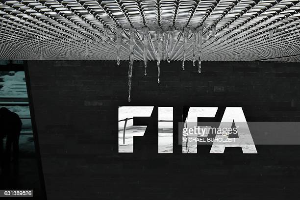 The logo of the International Federation of Association Football with hanging icicles is pictured at the FIFA headquarters in Zurich during meeting...