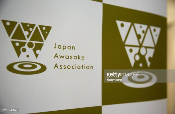 The logo of the Japan Awasake Association is displayed during a Sake Marche event at the Isetan Shinjuku department store operated by Isetan...