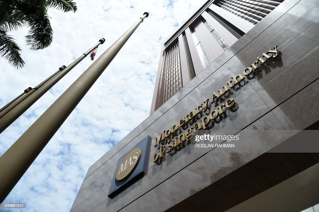 The logo of the Monetary Authority of Singapore is seen on its main building in Singapore on May 24, 2016. Singapore's central bank on May 24 said it was kicking out Swiss bank BSI, which has been linked to a global money-laundering scandal at Malaysia's state fund 1MDB that has embroiled Prime Minister Najib Razak. / AFP / ROSLAN
