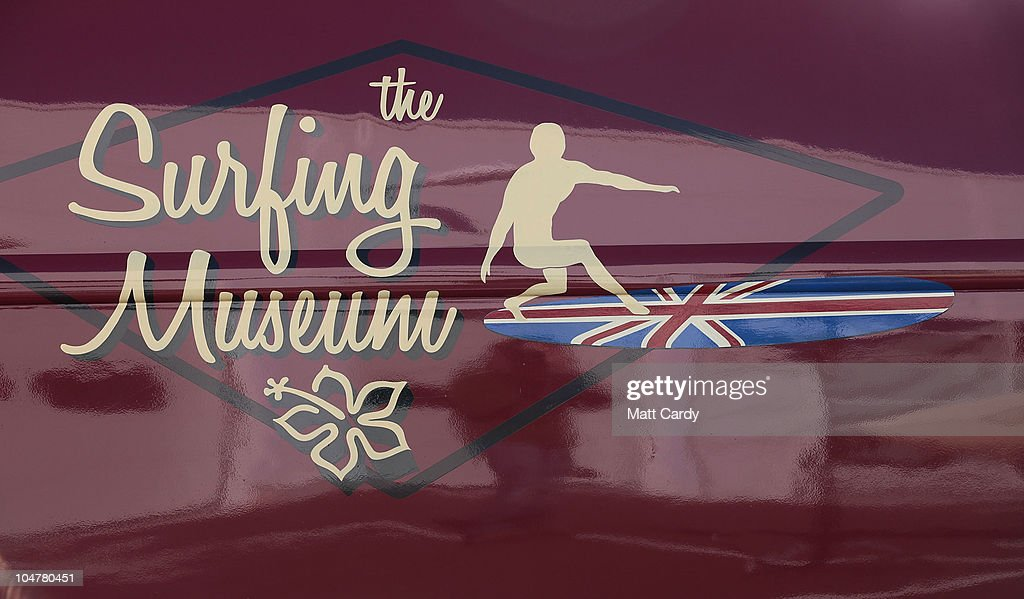 The logo of the Museum of British Surfing is displayed on a VW van on October 4, 2010 in Braunton, England. The Museum of British Surfing, a charity which originally started online, has been touring the UK since 2004 and is Europe's first surf museum. It holds the largest surfboard collection in Britain and has secured funding for a permanent home, which will open in Braunton next summer. As well as the collection of surfboards dating back over 100 years, the museum also holds early wetsuits, photos and other memorabilia relating to the phenomenal growth in the popularity of surfing. Although many people assume surfing in the UK began in the 1960s, the museum contains evidence that show that it was in fact already a mass participant activity on British beaches by the end of the First World War. Surfing is now a multi-million pound industry and employs 1000s of people in the UK.