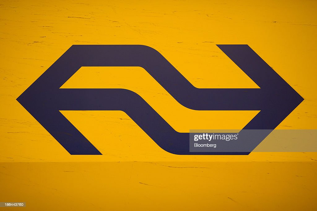 The logo of the Nederlandse Spoorwegen, the principal passenger railway operator in the Netherlands, sits on a DubbeldeksInterregiomaterieel (NS DD-VIRM) passenger train at the Utrecht Centraal station in Utrecht, Netherlands, on Thursday, Oct. 31, 2013. The European Union wants to prevent a requirement that at least 10 percent of energy for road and rail transport in 2020 come from renewable sources. Photographer: Jasper Juinen/Bloomberg via Getty Images