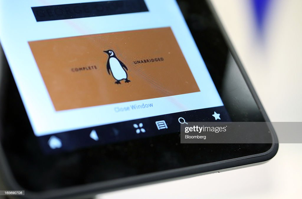 The logo of the Penguin publishing house, part of Pearson Plc, is seen on a Kindle Fire HD e-reader at a bookstore in London, U.K., on Friday, April 5, 2013. Bertelsmann SE's Random House won European Union approval to buy Pearson Plc's Penguin unit to create the largest book publisher in the U.K. and the U.S. Photographer: Chris Ratcliffe/Bloomberg via Getty Images