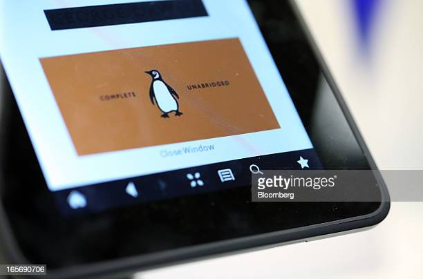The logo of the Penguin publishing house part of Pearson Plc is seen on a Kindle Fire HD ereader at a bookstore in London UK on Friday April 5 2013...