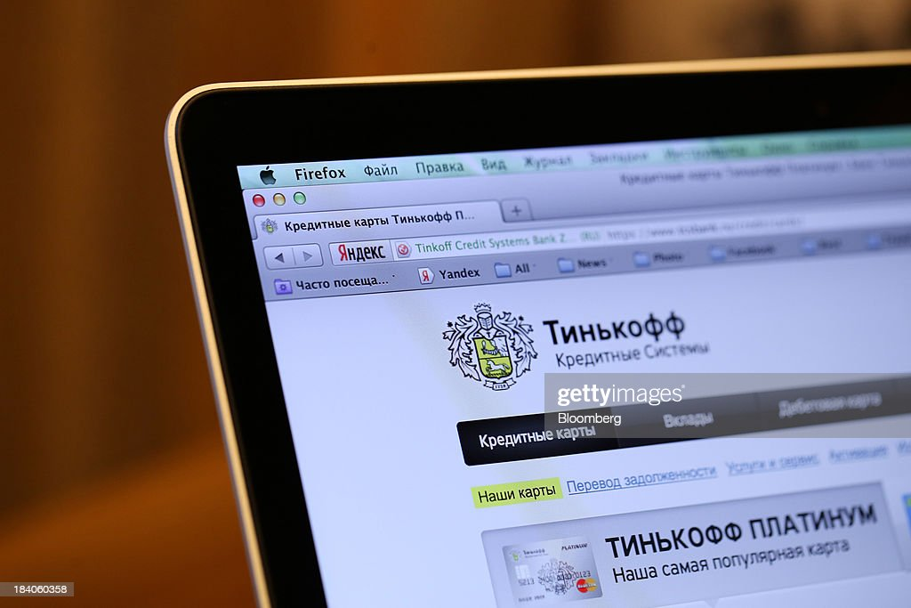 The logo of the Tinkoff Credit Systems online bank, operated by TCS Group Holding Plc, sits on an Apple Inc. iPad tablet in this arranged photograph in Moscow, Russia, on Friday, Oct. 11, 2013. Tinkoff is valued at $2.5b to $3b for London IPO, which reflects P/E multiple of 9.5 to 11.4, Vedomosti reports, citing unidentified people familiar with offering documents. Photographer: Andrey Rudakov/Bloomberg via Getty Images