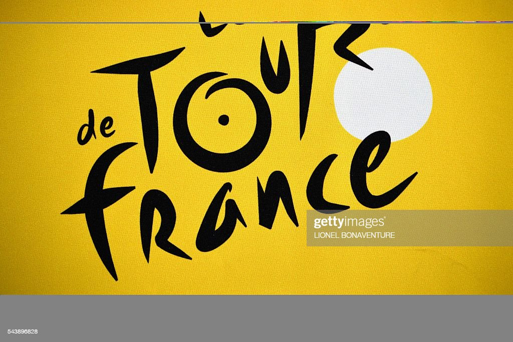 The logo of the Tour de France is pictured at the press center in Saint-Lo, on July 30, 2016, two days before the start of the 103rd edition of the Tour de France cycling race. The 2016 Tour de France will start on July 2 in the streets of Le Mont-Saint-Michel and ends on July 24, 2016 down the Champs-Elysees in Paris. / AFP / LIONEL