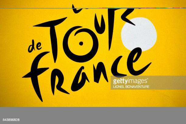 The logo of the Tour de France is pictured at the press center in SaintLo on June 30 two days before the start of the 103rd edition of the Tour de...