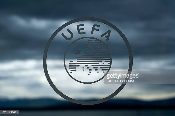 The logo of the UEFA is seen under dark clouds the European fooball governing body's headquarters in Nyon on April 15 2016 / AFP / FABRICE COFFRINI