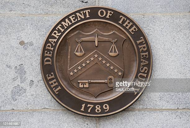 The logo of the US Treasury Department is seen on the outside of the Treasury building in Washington on August 19 2011 AFP PHOTO/Saul LOEB