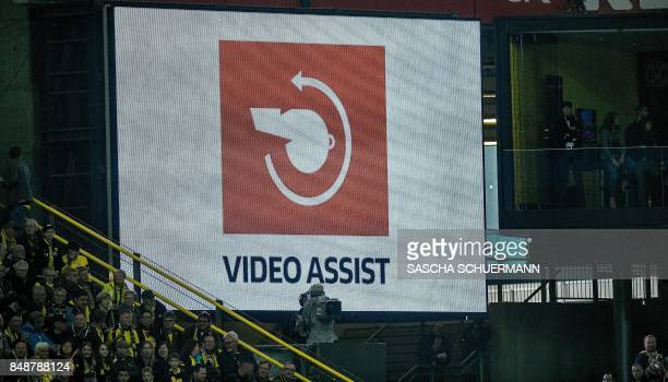 The logo of the video assistant referee is dispayed on a screen during the German first division Bundesliga football match Borussia Dortmund v FC...