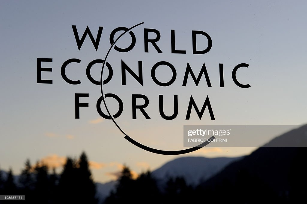 The logo of the World Economic Forum is seen on the building of the Davos Congress center as the sun sets on January 29 2011 in Davos Some 2500...