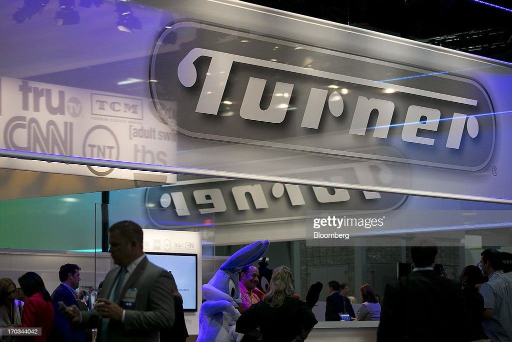 The logo of Turner Broadcasting System Inc. is seen on the exhibit floor during the National Cable and Telecommunications Association (NCTA) Cable Show in Washington, D.C., U.S., on Tuesday, June 11, 2013. The Cable Show is expected to bring in more than 10,000 attendees with 286 companies on the exhibit floor. Photographer: Andrew Harrer/Bloomberg via Getty Images