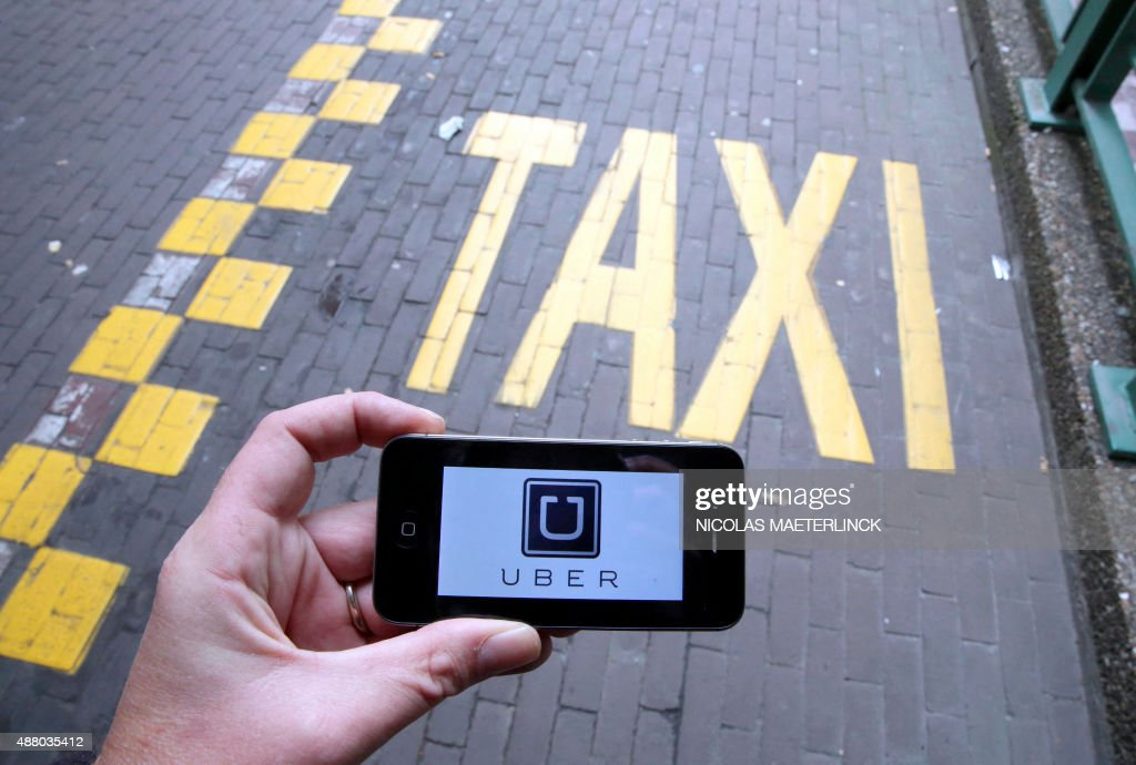 The logo of Uber car service app is seen on a smart phone during a protest by Brussels taxi drivers against the taxiapp Uber on September 13 in...