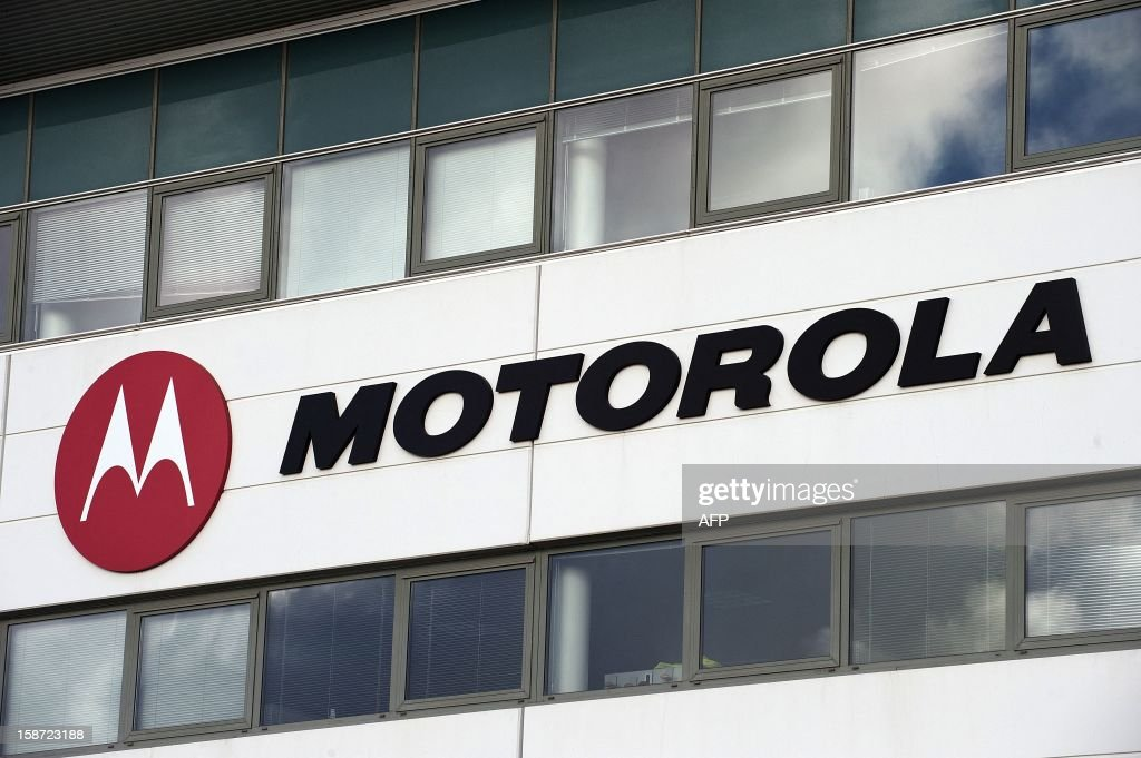 The logo of US Internet giant Google subsidury Motorola Mobility is pictured on December 26, 2012 at the plant in Toulouse, south western France. The mobile phone company announced last week that it could close it's site that employs some 170 people. AFP PHOTO / REMY GABALDA