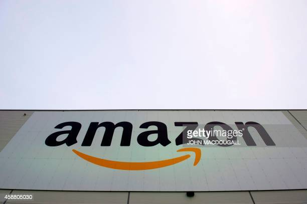 The logo of US online retail giant Amazon is displayed on the Brieselang logistics center west of Berlin on November 11 2014 The center is one of...