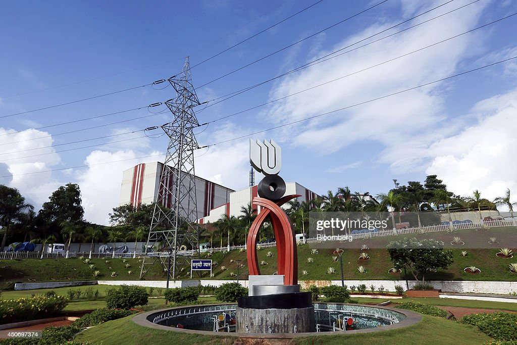 The logo of Uttam Galva Steels Ltd the Indian unit of ArcelorMittal is displayed atop a sculpture at the company's manufacturing facility in Khopoli...