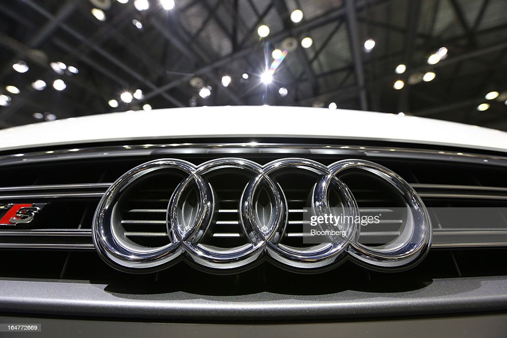 The logo of Volkswagen AG's Audi brand is displayed on the front grille of an Audi TTS vehicle during the press day of the Seoul Motor Show in Goyang, South Korea, on Thursday, March 28, 2013. The show runs from today until April 7. Photographer: SeongJoon Cho/Bloomberg via Getty Images