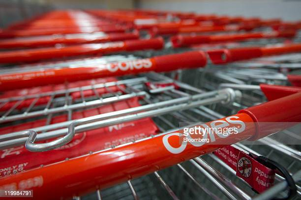 The logo of Wesfarmers Ltd's Coles supermarkets is displayed on shopping trolleys at a store in Sydney Australia on Thursday July 28 2011 Wesfarmers...