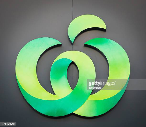 The logo of Woolworths Ltd's Woolworths chain of supermarkets is displayed outside an outlet in Sydney Australia on Tuesday Aug 27 2013 Woolworths...