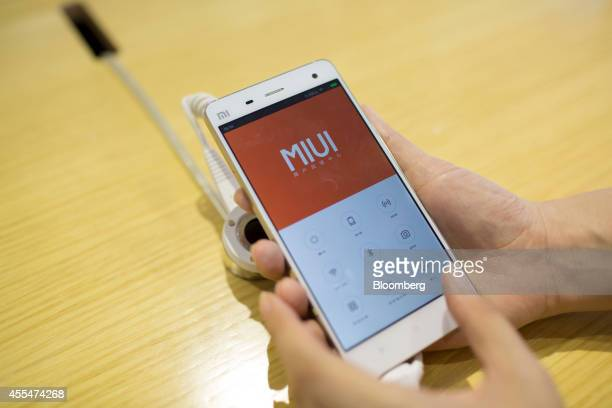 The logo of Xiaomi Corp's MIUI operating system is displayed on a Mi 4 smartphone in an arranged photograph at the company's showroom in Beijing...