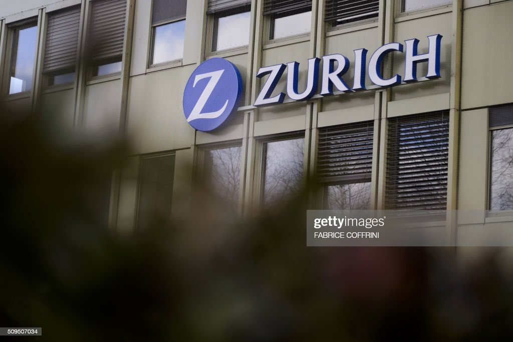 The logo of Zurich Insurance is seen on February 11, 2016 in Lausanne. The Swiss Zurich Insurance Group released the much lower figures for 2015, sealed by the costs of explosions in the Chinese port of Tianjin and the hurricanes in the United Kingdom and Ireland, but nevertheless decided to maintain its dividend. / AFP / FABRICE COFFRINI