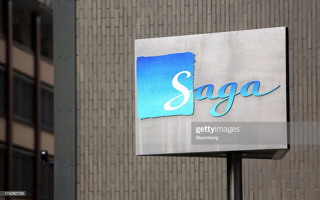 The logo sits on display outside the offices of Saga Group Plc in Hastings, U.K., on Tuesday, July 23, 2013. U.K. retail sales rose for a second month in June as discounts at department stores drove demand for clothes and electrical products. Photographer: Chris Ratcliffe/Bloomberg via Getty Images