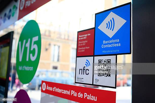The logos for Near Field Communication and Quick Response codes and contactless payment digital facilities sit at tagging points on a window in...