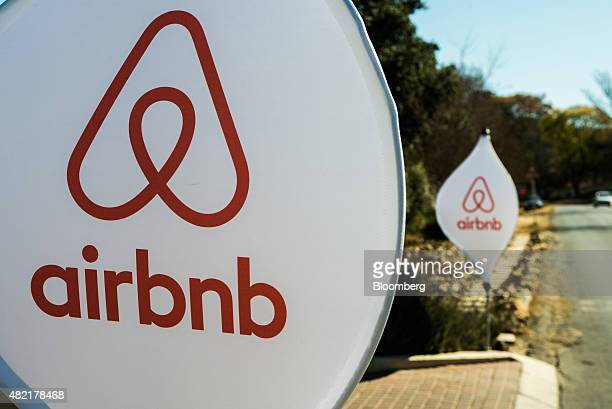 The logos of Airbnb Inc sit on banners displayed outside a media event in Johannesburg South Africa on Monday July 27 2015 Airbnb is hoping to spread...