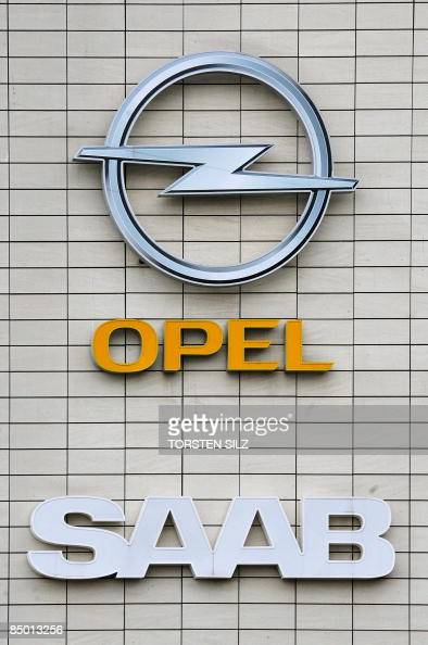 The logos of carmakers Opel and Saab can be seen on the front of Opels's plant in the central German city of Ruesselsheim on February 24 2009The...