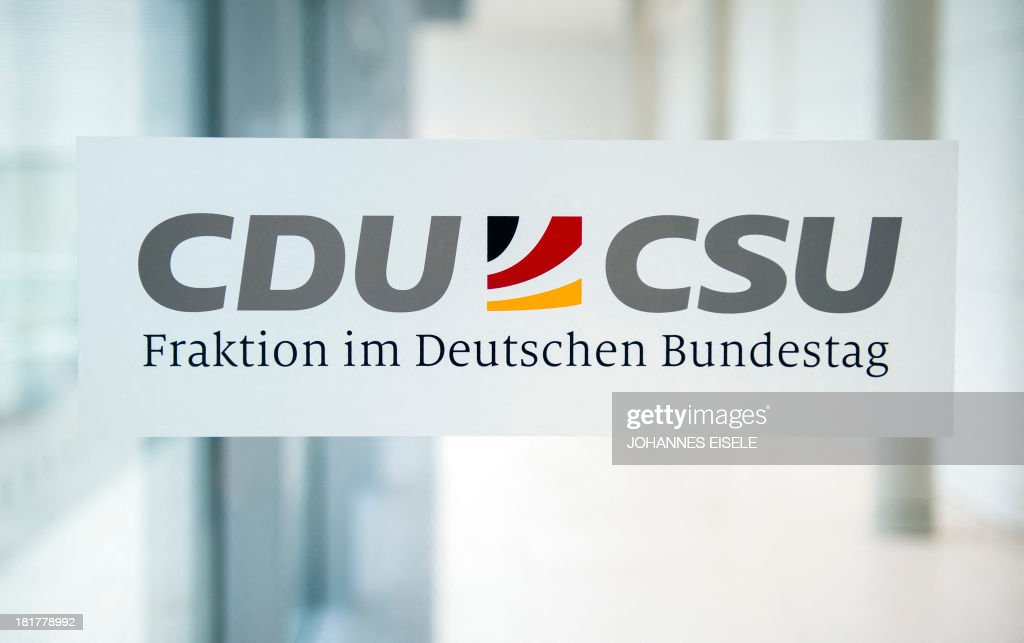 The logos of Germany's conservative CDU/CSU parties are seen at the union's parliamentary group rooms at the Bundestag (lower house of parliament) in Berlin on September 25, 2013. EISELE
