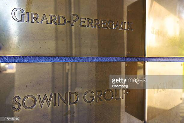 The logos of GirardPerregaux top and Sowind Group hang outside the company's wristwatch production site in La ChauxdeFonds Switzerland on Monday Sept...