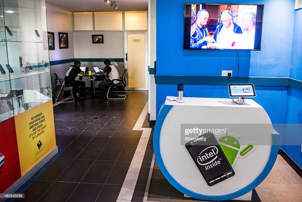 The logos of Intel Corp. and Android sit on display inside the m:lab East Africa center for mobile innovation at the i-Hub technology innovation center in Nairobi, Kenya, on Thursday, July 23, 2015. Together, the entrepreneurs come up with concepts like Ushahidi, the open-source software that's used to share information and interactive maps to prevent conflicts and help aid agencies provide relief in disaster zones. Photographer: Waldo Swiegers/Bloomberg via Getty Images