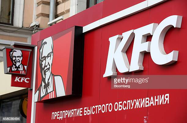 The logos of KFC sit on display outside a KFC fast food restaurant operated by Yum Brands Inc in Moscow Russia on Tuesday Oct 28 2014 More than 200...