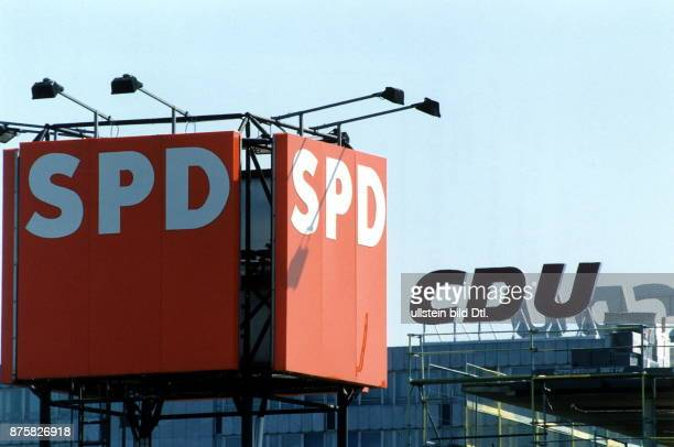 The logos of SPD and CDU on top of the respective party headquarters in Bonn