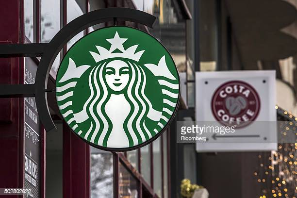 The logos of Starbucks Corp left and Costa Coffee sit outside coffee stores in Prague Czech Republic on Tuesday Dec 29 2015 Capital is flowing into...