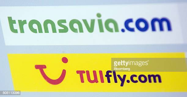 The logos of Transavia France SAS and TUI AG sit on a sign at the check in area inside Vienna International Airport operated by Flughafen Wien AG in...