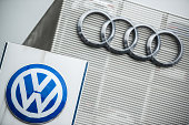 The logos of Volkswagen AG left and Audi AG sit outside an automobile dealership in Vienna Austria on Thursday Oct 8 2015 Volkswagen AG will probably...