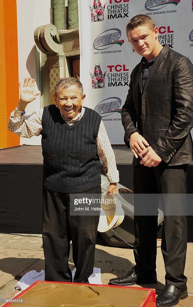 'The Lollipop Kid' actor <a gi-track='captionPersonalityLinkClicked' href=/galleries/search?phrase=Jerry+Maren&family=editorial&specificpeople=3637561 ng-click='$event.stopPropagation()'>Jerry Maren</a>, 93, Last Of The 'Munchkins' from 'The Wizard Of Oz' and NASCAR Driver/host for the event Gray Gaulding attend the Handprint-Footprint Ceremony at the TCL Chinese Theatre on September 18, 2013 in Hollywood, California.